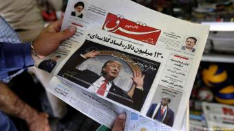 A man reads a newspaper article about Trump in Tehran (photo: Getty Images/A. Kenare)