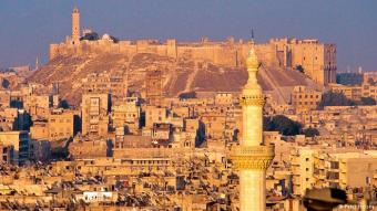 Aleppo before the war: a photo taken in 2001, when no-one suspected the suffering and destruction the city would experience barely a decade later. It shows Aleppo's citadel peacefully overlooking the Old Town bathed in a golden light. At the time, the minaret of the Great Mosque had just been scaffolded for renovation