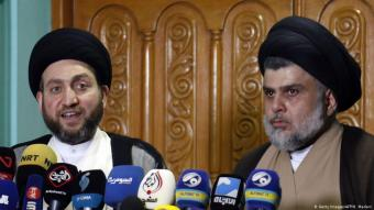 Iraqi Shia Muslim leader and head of Hikma party Ammar al-Hakim (l) and Shia cleric Muqtada al-Sadr speak to the media during a meeting in the Iraqi holy city of Najaf on 17 May 2018 (photo: Getty Images/AFP/H. Madani)