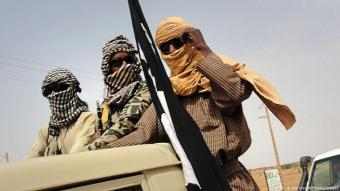 Jihadists of the MUJAO movement stand guard at Gao airport in Mali on 7 August 2012 (photo: Ollo Hien/AFP/Getty Images)