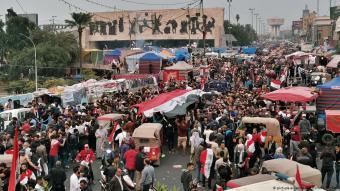 Crowds on Baghdad's Tahrir Square celebrate following the announcement of Prime Minister Mahdi's resignation (photo: AP Photo/Hadi Mizban)