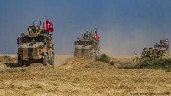 Turkish military vehicles (photo: Getty Images/AFP/D. Souleiman)
