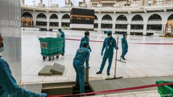 Ahead of this year's hajj, the most important pilgrimage for Muslims, crews at the Grand Mosque were busy with more than just the usual cleaning and maintenance work. To keep people at a distance from each other and avoid spreading the virus, strips of tape have been stuck to the ground around the Kaaba, Islam's most sacred site, showing people where to walk
