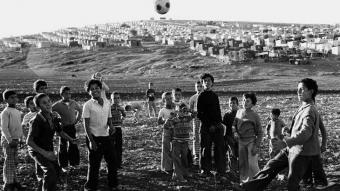 Palestinian children playing football in the Huson Camp in Jordan, 1977 (photo: UNRWA Archive/M. Nasr)