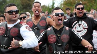 Members of a New Zealand biker gang perform the haka in tribute to those killed in the March 15 Christchurch twin mosque massacre, outside the Jamia Masjid mosque in Hamilton on 22 March 2019 (photo: Getty Images/AFP/M. Bradley)