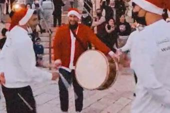 Palestinians dance a Christmas dabkeh to Jingle Bells (source: Middle East Monitor)