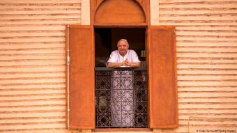 Moroccan Jewish man looks out of a window in the Jewish quarter of Marrakesh (photo: Getty Images/AFP/Fadel Senna)