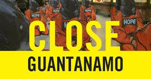Banner decrying detentions at Guantanamo detention facility (source: amnesty.org.uk)