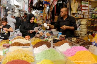 An Iraqi woman shops at a wholesale market ahead of the holy fasting month of Ramadan, in Mosul, Iraq, 12 April 2021 (photo: Reuters)