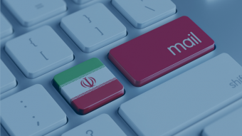 Keyboard showing red mail key and Iranian flag_Shutterstock - xtock