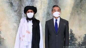 China's Foreign Minister Wang Yi at a meeting with Taliban leader Mullah Abdul Ghani Baradar in July (photo: dpa/picture-alliance)
