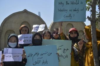 Afghan women hold banners and placards as they take part in an anti-Pakistan protest in Kabul on 8 September 2021 (photo: Hoshang Hashimi/AFP)