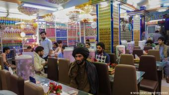 It's a man's world: photos and videos emerging from Afghanistan show bustling activity returning to the streets of cities – as at this restaurant in Herat, where customers are being welcomed back. But there is one conspicuous difference from before: at the tables are men and men alone, often wearing the traditional knee-long tunic. Women have become a rarity in the urban landscape