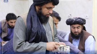 Men are pictured as the Taliban-controlled central bank seizes a large amount of money in cash and gold from former government officials (photo: DA Afghanistan Bank/Reuters)