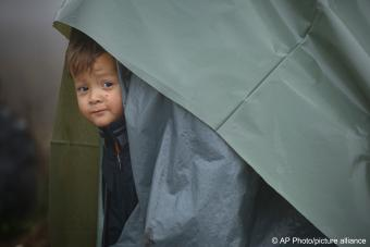 With some of the shelters no more than sticks covered by nylon sheeting, the settlement sprawls over a muddy field near the town of Velika Kladusa, a few kilometres from the border with Croatia, a European Union member